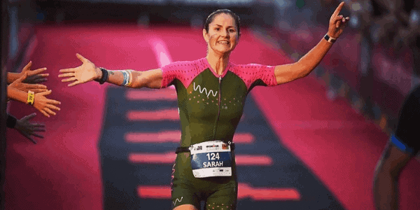woman finishing ironman race