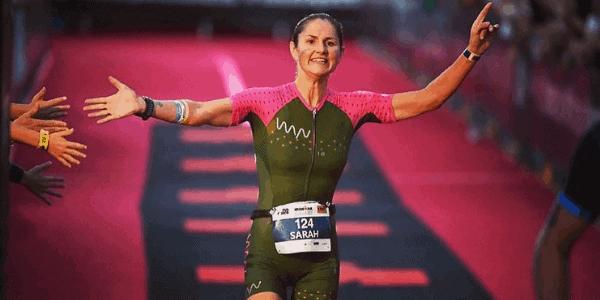 woman finishing ironman race