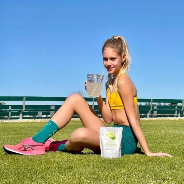 girl drinking sports electrolyte
