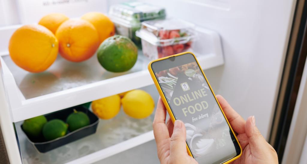 phone and food in fridge