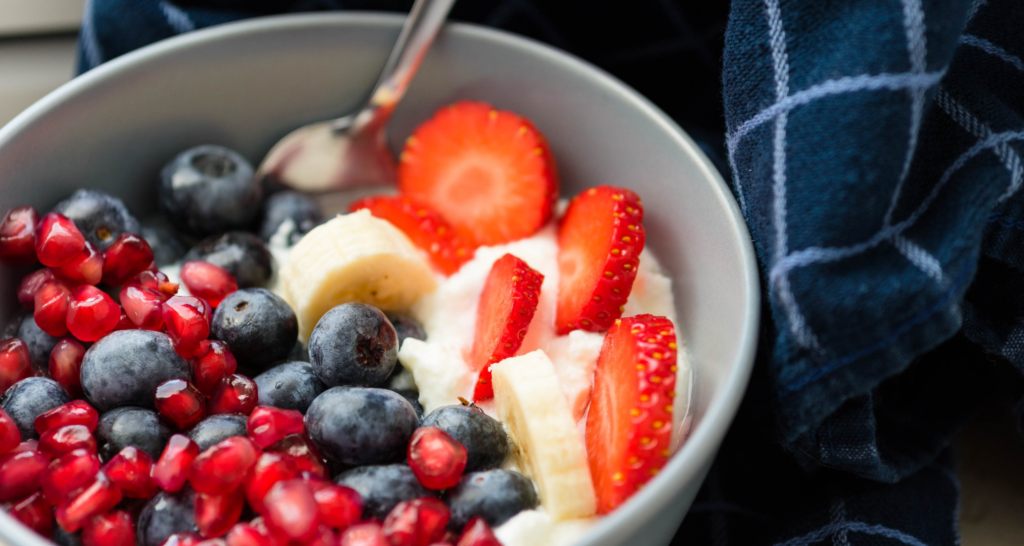 mixed fruit with yoghurt on a bowl