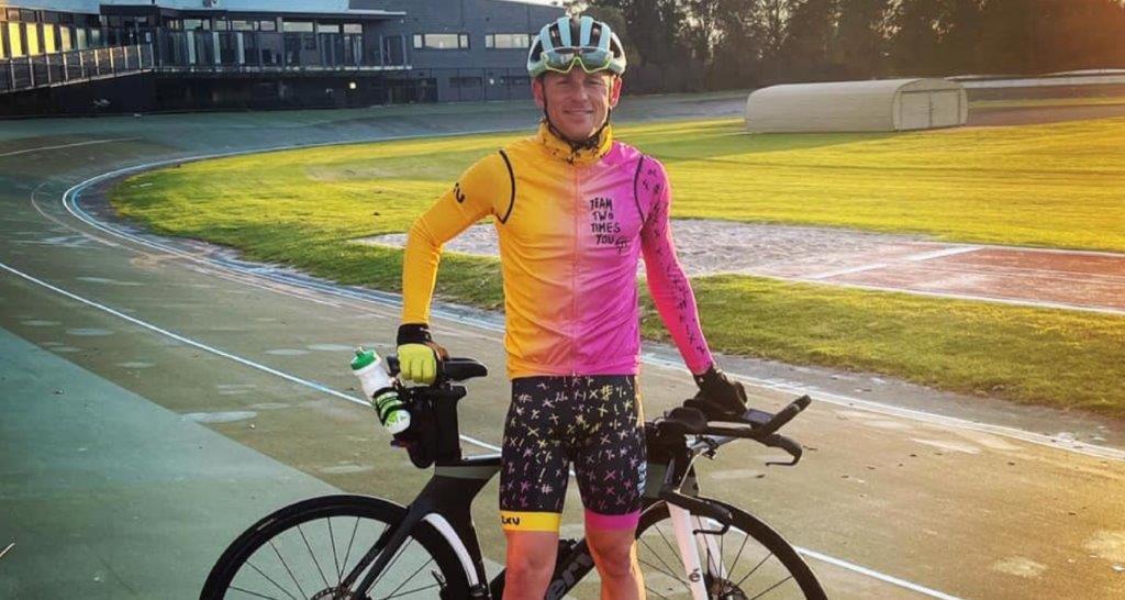 man standing next to bike