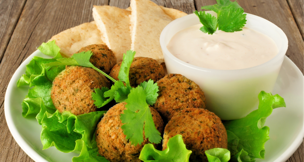 Falafel balls and dip in a plate