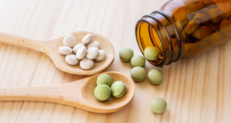 vitamins tablet on the wood spoon